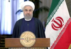 Iranian President Hassan Rouhani attend a news conference with Swiss President Johann Schneider-Ammann in Tehran
