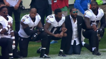 ray lewis kneeling