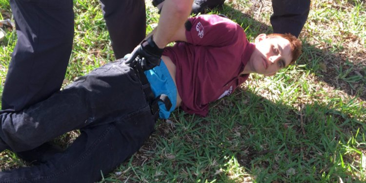 Nikolas-Cruz laying on the ground