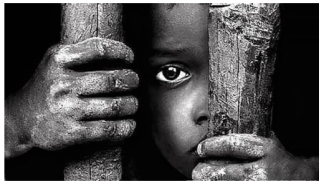 black child behind cage