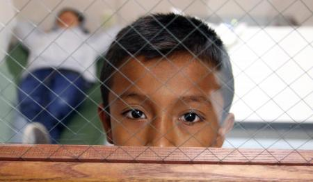 immigrant child behind cage
