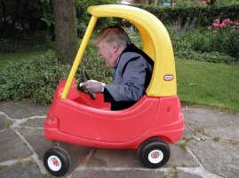 kiddy car with trump behind the wheel