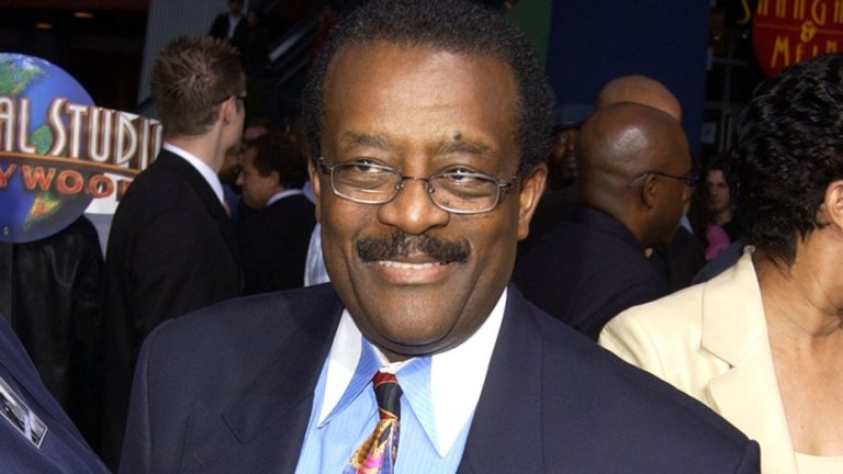 johnnie cochran mole over left eye