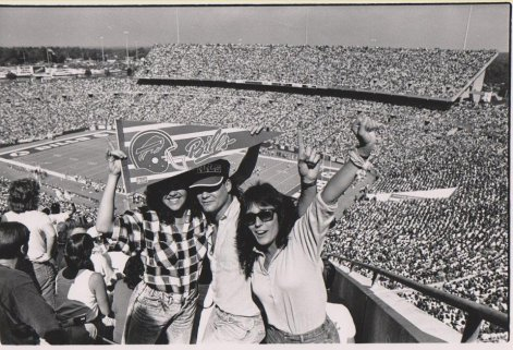 This image has an empty alt attribute; its file name is rich-stadium-folks.jpg